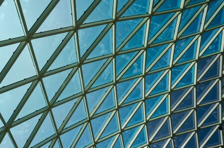 Glass windows grid on blue sky