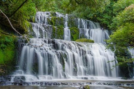 Purakaunui Falls, The Catlins, south island of New Zealand. Beautiful stairway waterfall. Stock Photo