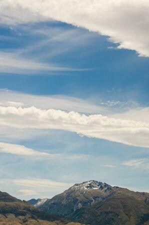 Mountain on blue cloudy sky Standard-Bild