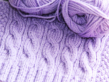 purl: Purple knitted pattern spokes Braids and two coil of yarn
