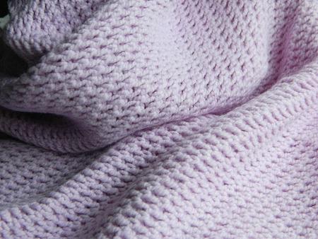 bedspread: Knitted using spokes openwork purple blanket Stock Photo