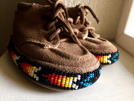 native american baby: Beaded Native American infant shoes Stock Photo