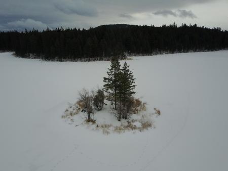Island in a frozen lake