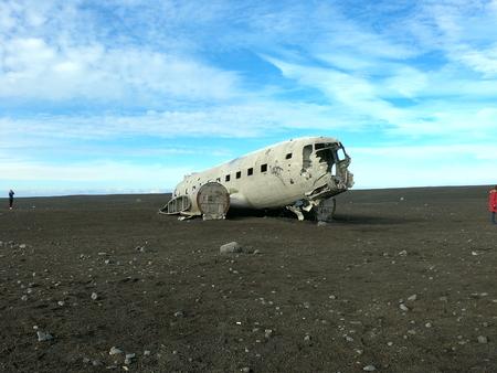 Airplane on black sand