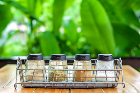 seasoning: Four bottles of seasoning Stock Photo