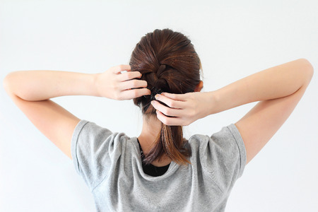 hair tied: woman tied her hair Stock Photo