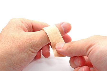 putting bandage on thumb