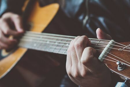 acoustic guitar: close-up, hand playing on acoustic guitar Stock Photo