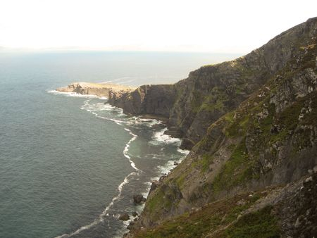 A magnificent view of cliffs and ocean from the hills at the Foger Cliffs, Valentia Island, Ring of Kerry, Ireland photo