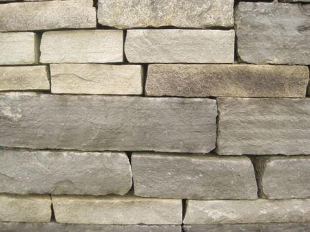 A wall built of beautiful gray stones (background) Stock Photo