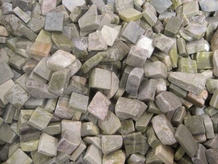 Cubic marble stones in green and gray colors (background)