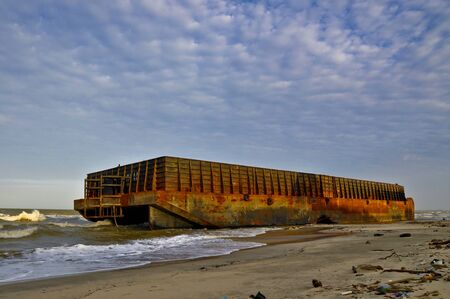 huge barge stranded at beach Stock Photo
