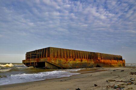 stranded: huge barge stranded at beach Stock Photo