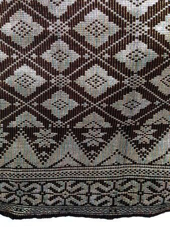 Songket  a fabric patterned with gold or silver threads Stock Photo