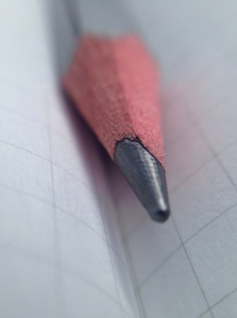 grid background: Super close up pencil with grid background Stock Photo