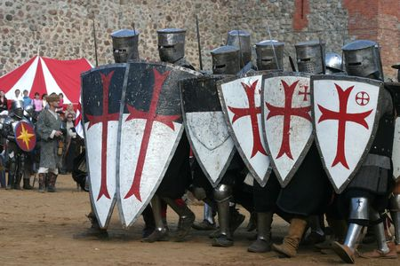 historical battle: Knights in an armour and with the weapon, going to fight
