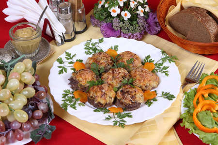 Celebratory supper with cutlets, fruits & vegetables photo