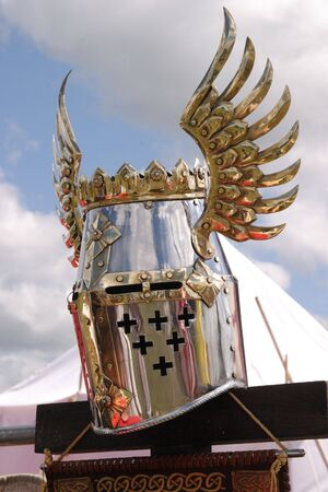 Knightly helmet on a background of the sky