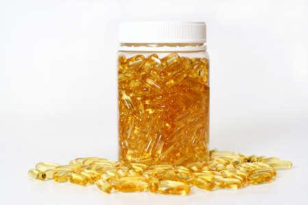 brink: Glass pot with gold shiny boluses Stock Photo