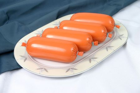 Ready boiled sausage on a plate