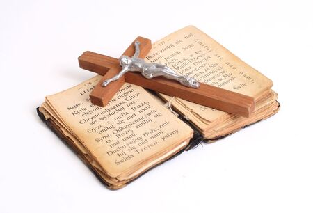 Open old holy bible with wood cross Stock Photo