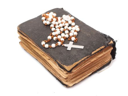 disciples: Old holy bible with cross