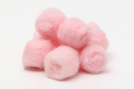 Pink hygienic cotton balls isolated on a white background