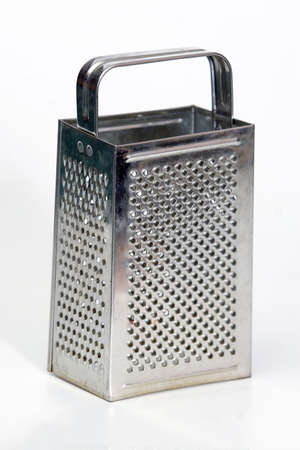 grater: stainless steel grater on table
