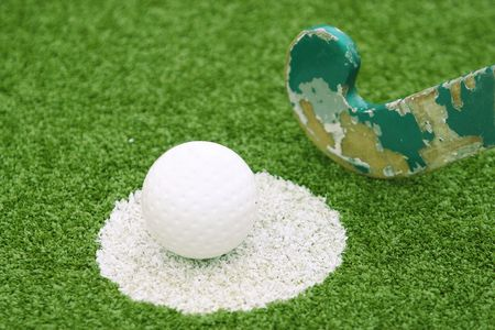 Stick and ball on a green grass Stock Photo