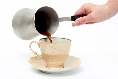 cezve: cup of coffee with aluminum cezve