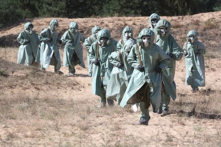 Group of people in protective suits