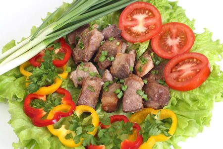 Appetizing shish kebab with tomatoes and greens Stock Photo