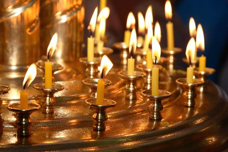 Church wax candles on a candlestick