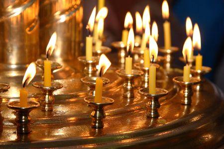 Church wax candles on a candlestick