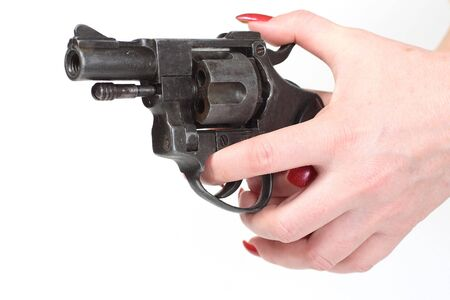 sixshooter in hand - isolated on white background photo