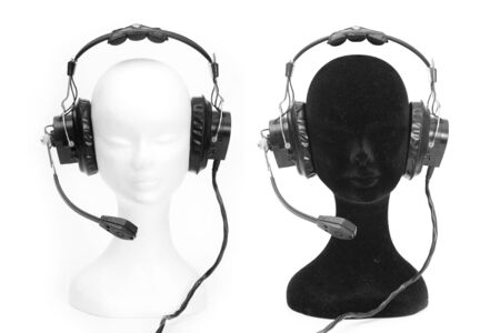 White and black heads dummies with headphones photo