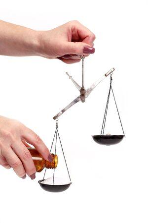 unbalanced: pharmaceutical scales unbalanced conceptual isolated on white
