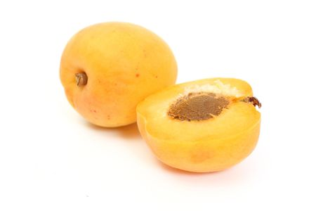 Apricot with halves on white background