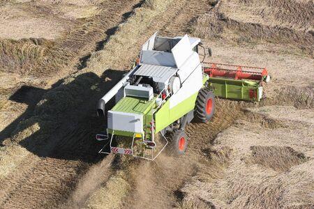 Machine harvesting the corn field Stock Photo - 3759028