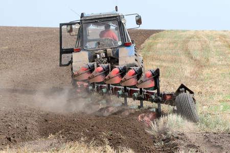 Machine harvesting the corn field Stock Photo - 3758976