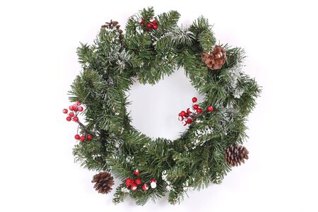 Christmas wreath with red berries and cones  photo