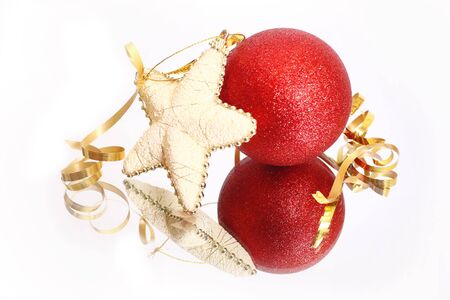 A silver christmas star, red christmas bauble and gold ribbon on white photo