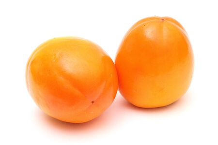 Pair of juicy ripe persimmons photo