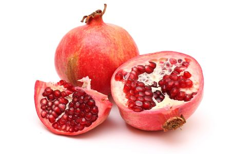 pomegranate juice: Fresh appetizing pomegranates on white background Stock Photo