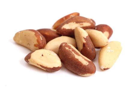 Brazil nuts (Bertholletia excelsa) isolated on a white Stock Photo