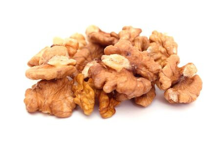 Dry walnuts isolated on a white photo