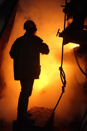 Hot work of steel maker in helmet Stock Photo