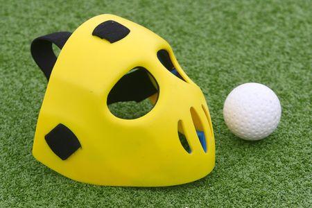 Field hockey equipment on green grass Stock Photo