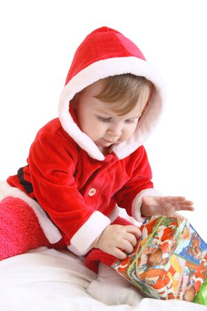 Little happy girl in red santa's clothes with present isolated on white Stock Photo - 6383260