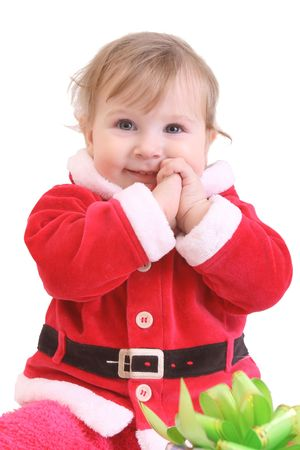Little happy girl in red santa's clothes with present isolated on white photo